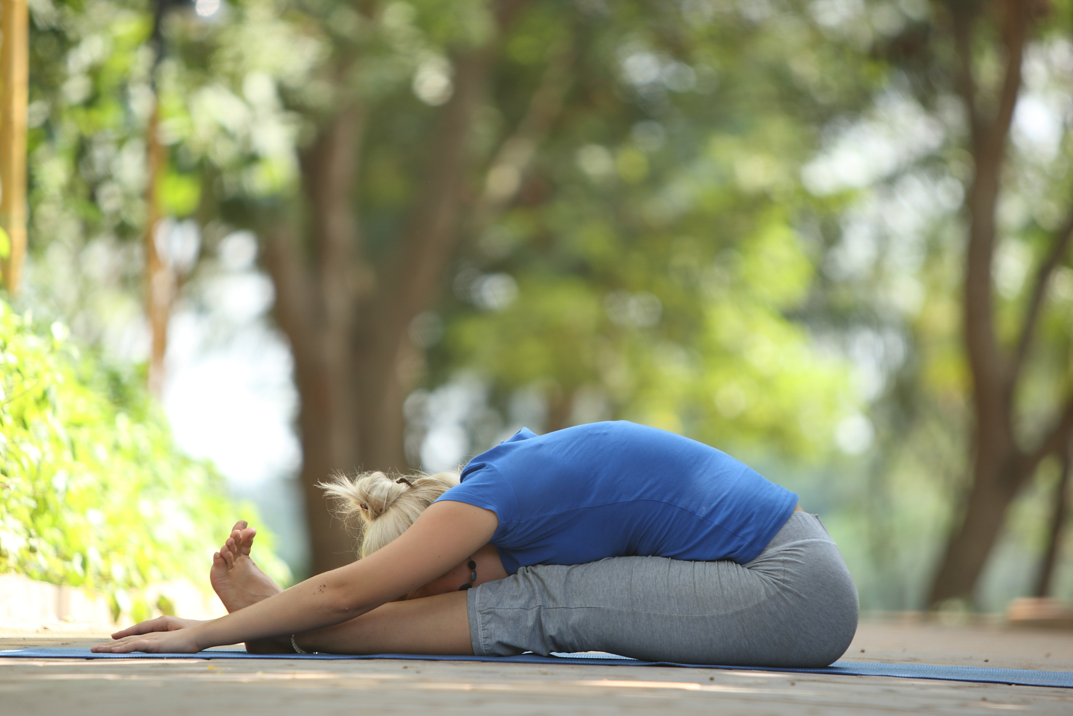 Paschimottanasana (Seated Forward Bend Yoga Pose) for good digestion