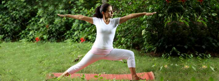 Breathe with awareness while in a yoga pose